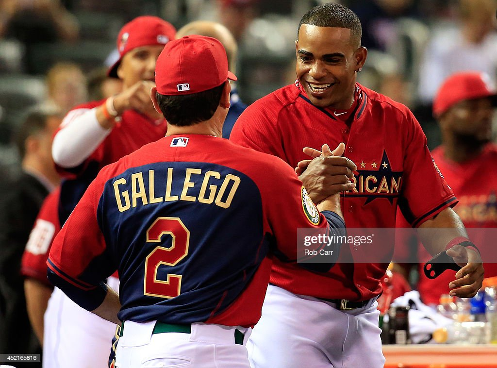 American League All-Star Yoenis Cespedes #52 of the Oakland A's celebrates with coach Mike Gallego, who threw to him in competition, after winning the Gillette Home Run Derby at Target Field on July 14, 2014 in Minneapolis, Minnesota.