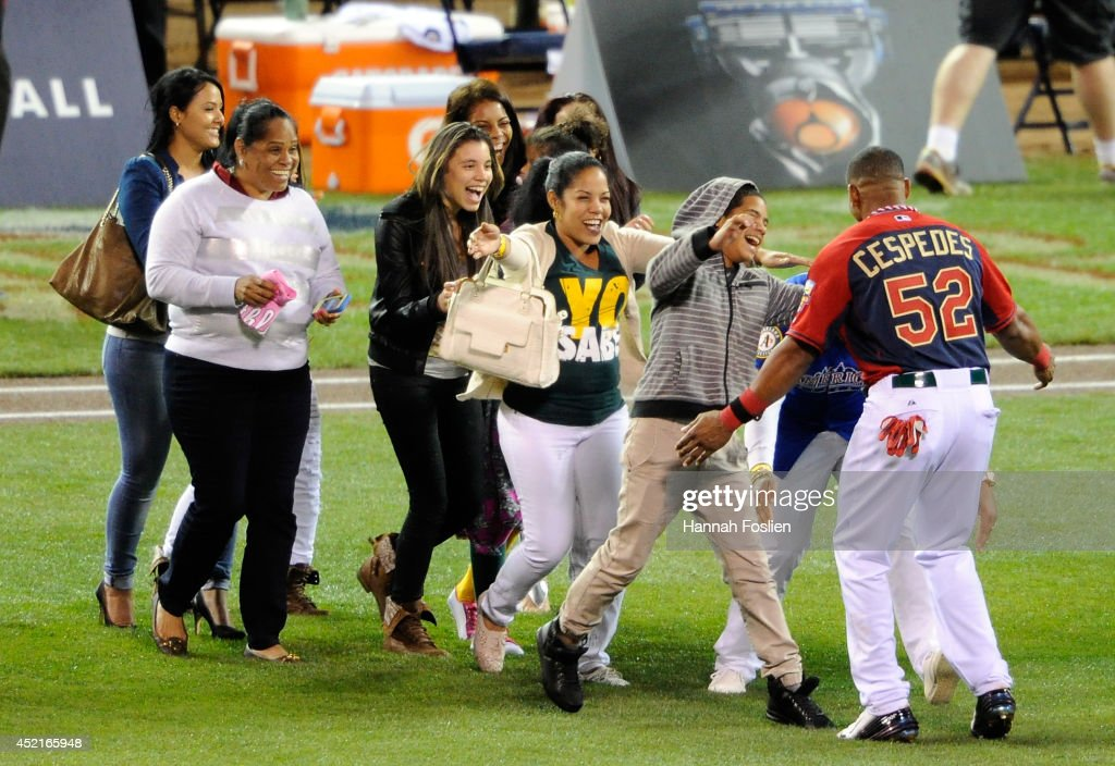 American League All-Star <a gi-track='captionPersonalityLinkClicked' href=/galleries/search?phrase=Yoenis+Cespedes&family=editorial&specificpeople=8892047 ng-click='$event.stopPropagation()'>Yoenis Cespedes</a> #52 of the Oakland A's celebrates with his family after winning the Gillette Home Run Derby at Target Field on July 14, 2014 in Minneapolis, Minnesota.