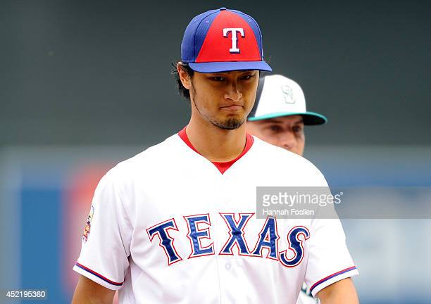 American League AllStar Yu Darvish of the Texas Rangers walks off the field during batting practice before the 85th MLB AllStar Game at Target Field...