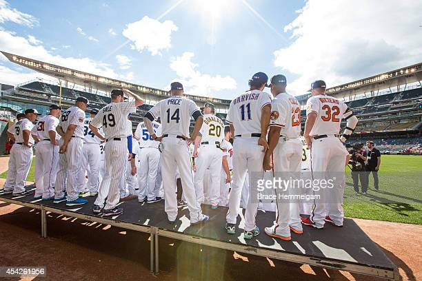 American League AllStars line up for the team photo during the 85th MLB AllStar Game at Target Field on July 15 2014 in Minneapolis Minnesota