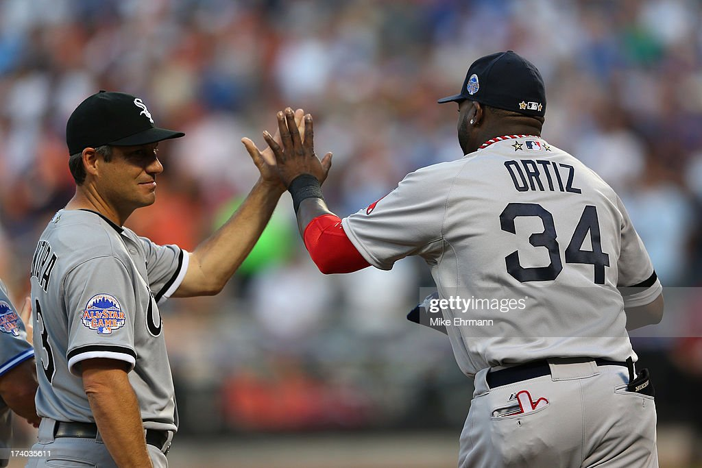 American League All-Stars manager Robin Ventura of the Chicago White Sox high-fives American League All-Star David Ortiz #34 of the Boston Red Sox during the 84th MLB All-Star Game on July 16, 2013 at Citi Field in the Flushing neighborhood of the Queens borough of New York City.