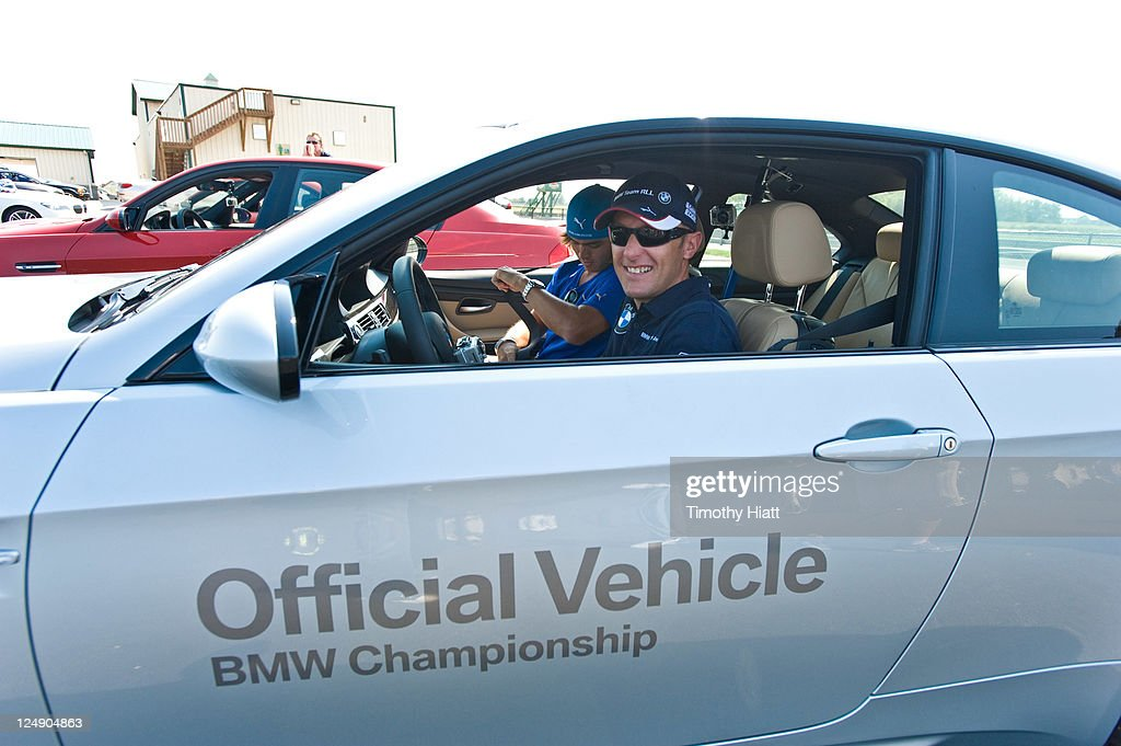 American LeMans Series race driver Joey Hand test drives BMWs to raise money to benefit the Evans Scholars Foundation at Autobahn Racetrack on September 13, 2011 in Joliet, Illinois.