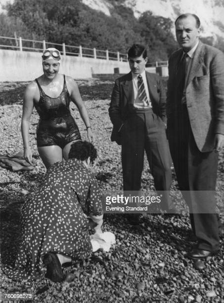 American longdistance swimmer Florence Chadwick preparing to enter the water at St Margaret's Bay near Dover Kent in her attempt at a nonstop double...