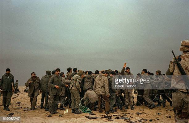 American Marines distribute MRE rations to several hundred captured Iraqi soldiers in the Kuwait desert at the start of ground operations in the...