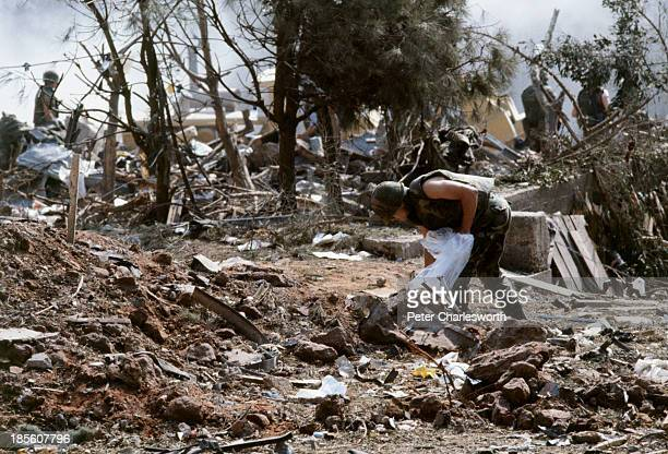 American Marines search for survivors and bodies in the rubble all that was left of their barracks head quarters in Beirut after a terrorist suicide...
