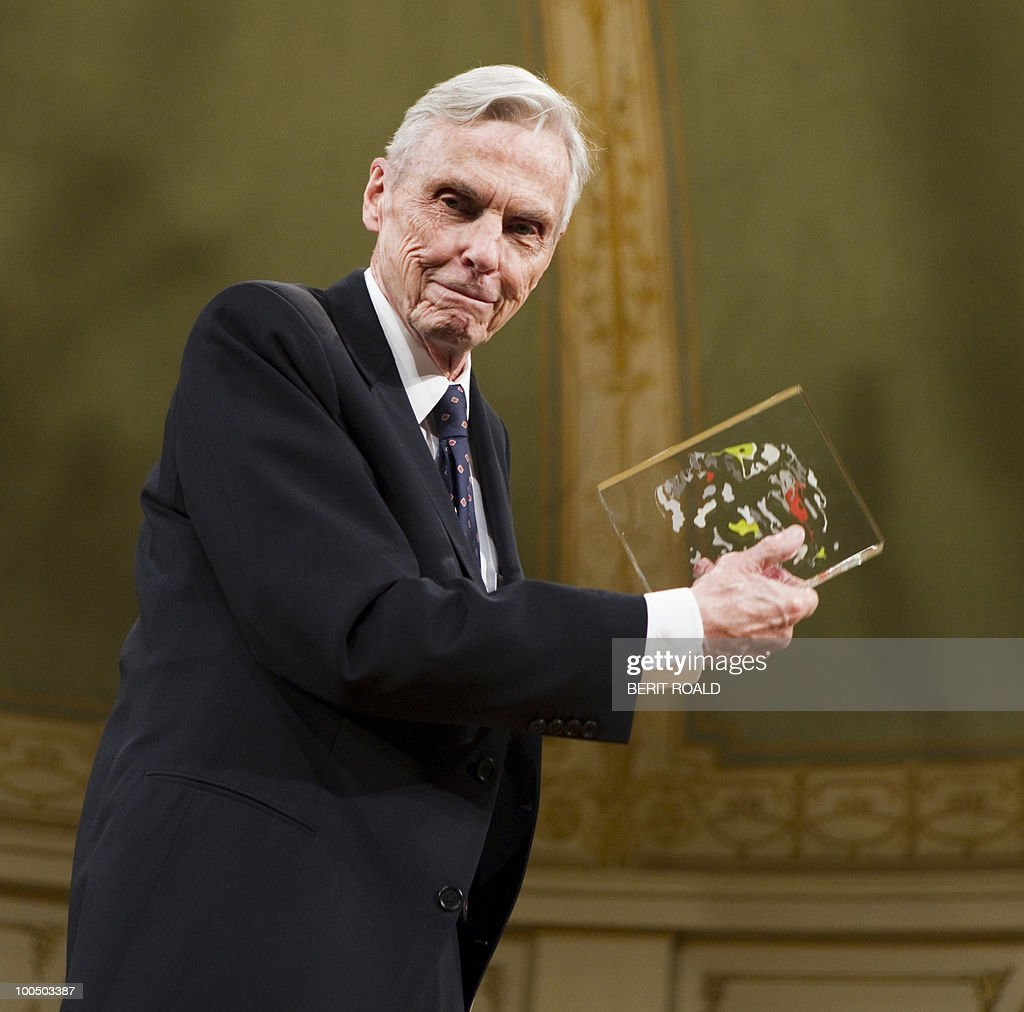 American mathematician John Torrence Tate of the University of Texas displays his award as he receives the Abel Prize by King Harald (unseen) of Norway in Oslo on May 25, 2010. The Abel Prize carries a cash award of NOK 6,000,000 (close to � 730,000 or US$ 1 mill.) is awarded by the Norwegian Academy of Science and Letters. AFP PHOTO NORWAY Berit Roald