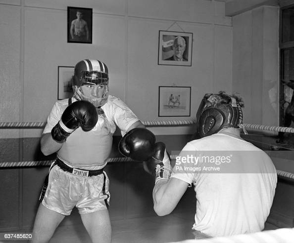 American Middleweight Don Fullmer who fights Great Britain's Terry Downes in a few days in training wearing a special chest protector made of leather...