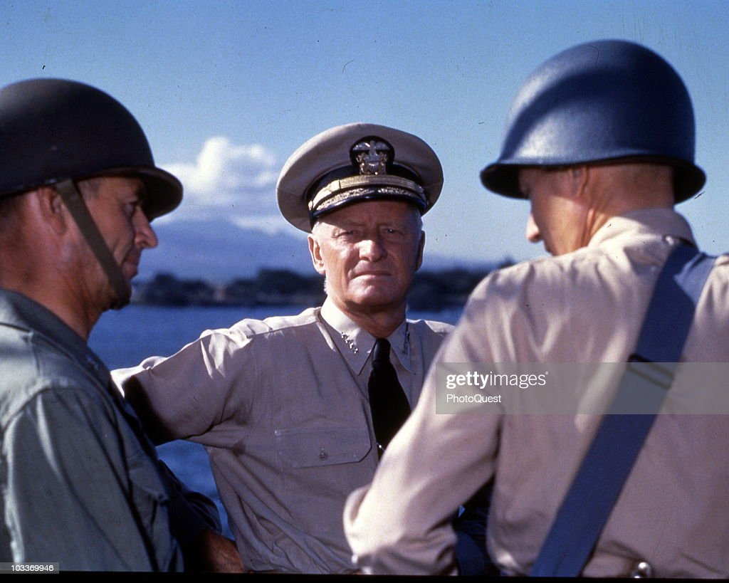 American military commander Admiral (and later Fleet Admiral) Chester William Nimitz (1885 - 1966) discusses strategy for the Gilbert and Marshall Islands campaign with two unidentified others, Pearl Harbor, Hawaii, October 1943.