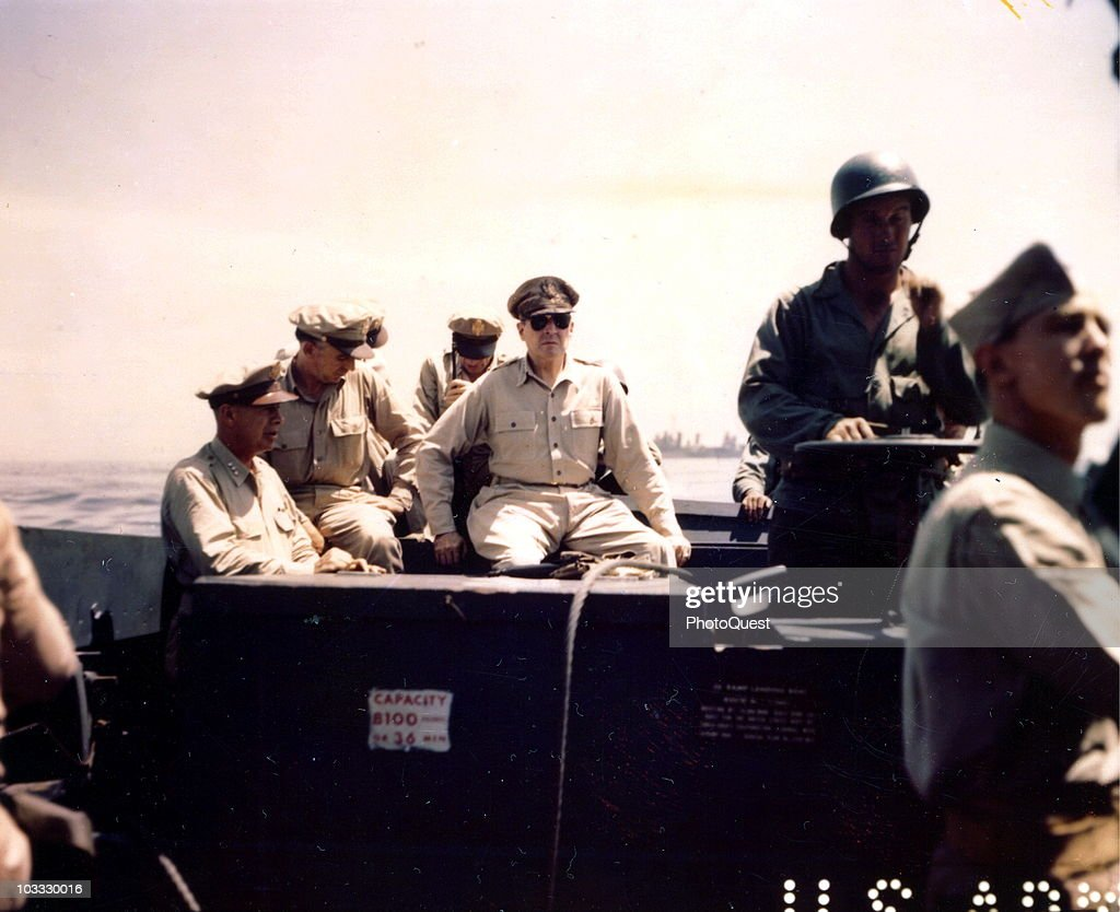 American military commander General Douglas MacArthur (1880 - 1964) (center) inspects the beachhead on Leyte Island, accompanied by Lieutenant General George C. Kenney (1889 - 1977), Lieutenant General Richard K. Sutherland (1893 - 1966), and Major General Verne D. Mudge, Leyte, Philippines, October 20, 1944.