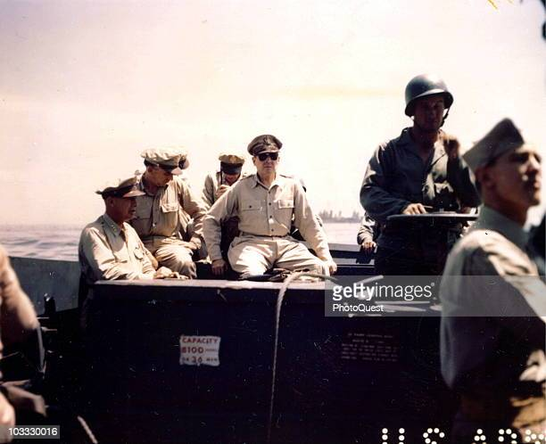 American military commander General Douglas MacArthur inspects the beachhead on Leyte Island accompanied by Lieutenant General George C Kenney...