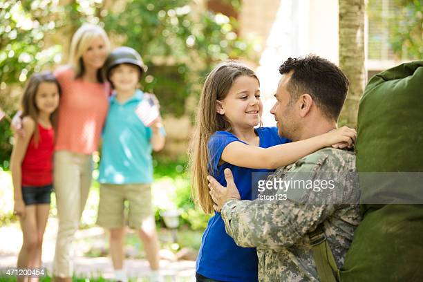 American military veteran welcomed home by family. Mom, children. Home.