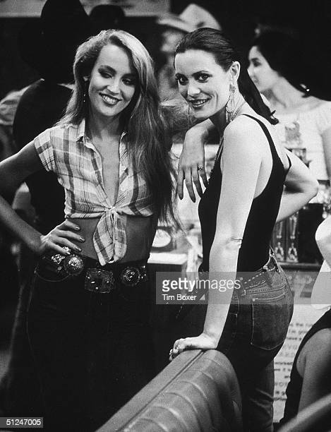 1980 American model and actor Jerry Hall and her sister Cindy at a party for director James Bridges's film 'Urban Cowboy' held at Gilley's Pasadena...
