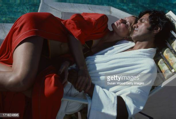 American model and actress Cheryl Tiegs and her husband film director Stan Dragoti relax together beside a pool at La Costa Resort Spa Carlsbad...