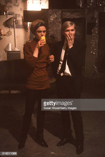 American model and actress Edie Sedgwick poses with Pop artist Andy Warhol in the latter's studio the Factory New York New York 1967