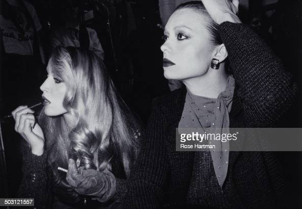 American model and actress Jerry Hall and a catwalk model at a Krizia fashion show 1979