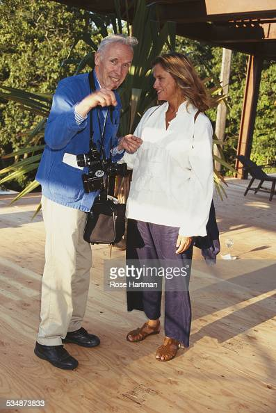 American model and actress Lauren Hutton with American fashion photographer Bill Cunningham at the Watermill Center Summer Benefit Water Mill New...