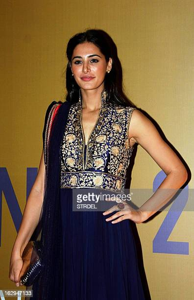 American model and actress Nargis Fakhri attends the NGO fund raiser Equation 2013 sponsored by Bollywood actor Rahul Bose in Mumbai on March 1 2013...