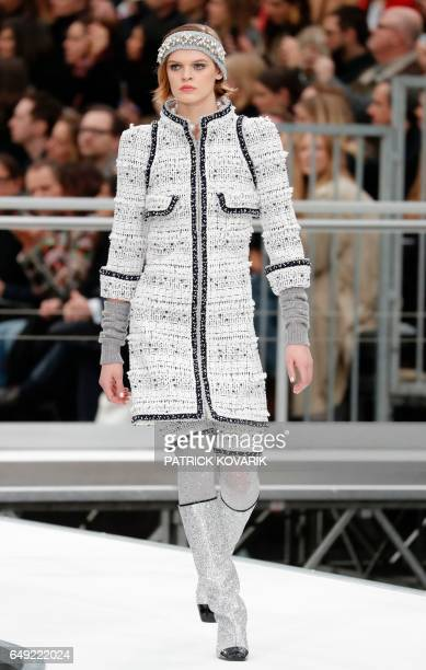 American model Cara Taylor presents a creation by Chanel during the women's FallWinter 20172018 readytowear collection fashion show at the Grand...