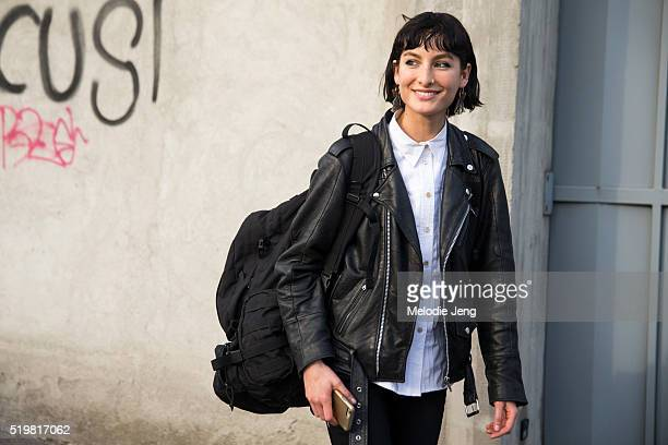 American model Heather Kemesky wears a black leather jacket a black backpack and a white buttonup top after the Pucci show during the Milan Fashion...