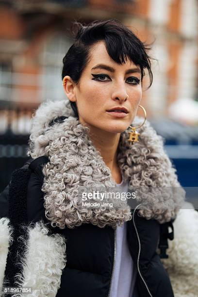American model Heather Kemesky wears a personalized 'H' earring Sandy Liang fur jacket a nose ring and doubleliner eye makeup after the Topshop show...