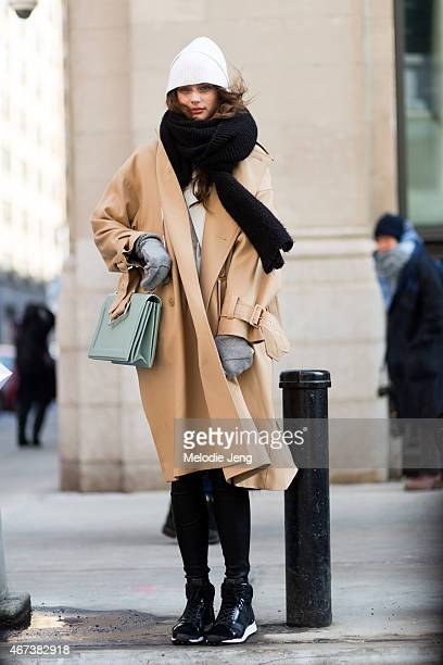 American model Taylor HIll exits the Public School show in a 31 Phillip Lim coat and bag on Day 5 of New York Fashion Week Fall/Winter 2015 on...