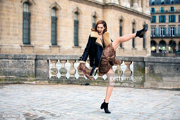 American model Teddy Quinlivan exits the Dior show at Carrée du Louvre with a kick on Day 4 of PFW FW16 on March 04 2016 in Paris France Teddy wears...