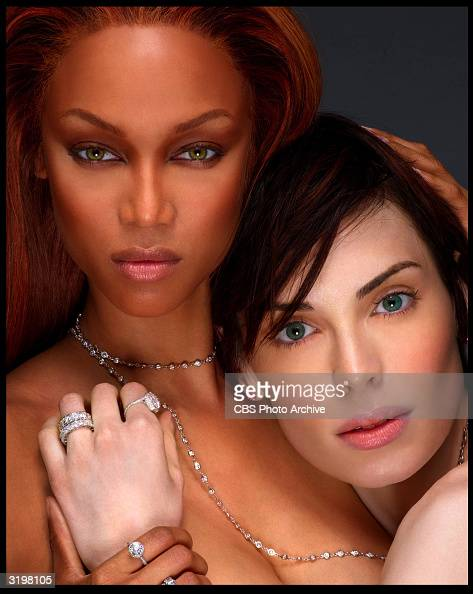 American models Tyra Banks and Yoanna House pose together after House 'won' the UPN television series 'America's Next Top Model' a program created...