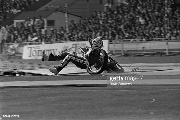 American motorcycle stunt rider Evel Knievel crashes on landing after jumping 13 AEC Merlin buses at Wembley Stadium London 26th May 1975 After the...