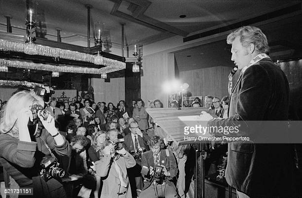 American motorcycle stunt rider Evel Knievel giving a press conference in London prior to his attempt to jump 13 buses at Wembley Stadium May 1975...