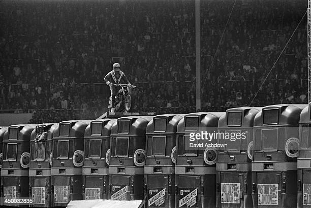American motorcycle stunt rider Evel Knievel making preliminary checks at the top of the launch ramp before his attempt to jump 13 AEC Merlin buses...