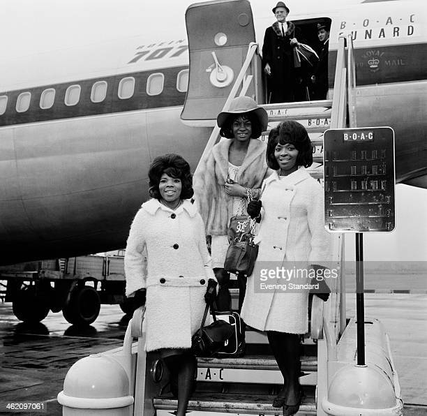 American Motown vocal group Martha And The Vandellas arriving at London Airport London 15th March 1965 Left to right Rosalind Ashford Martha Reeves...