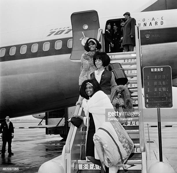 American Motown vocal group The Supremes arriving at London Airport London 15th March 1965 From top to bottom Diana Ross Florence Ballard and Mary...