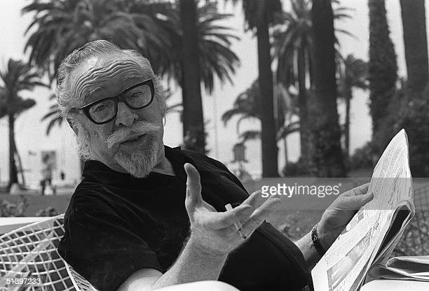 American movie director Dalton Trumbo pose for photographer 17 May 1971 in Cannes as he presents his latest movie 'Johnny Got His Gun' Trumbo was a...