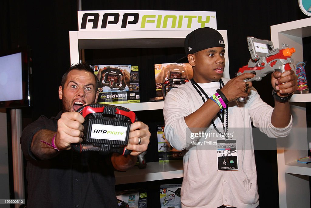 American Music Awards red carpet hosts Shay Carl and <a gi-track='captionPersonalityLinkClicked' href=/galleries/search?phrase=Tristan+Wilds&family=editorial&specificpeople=3025356 ng-click='$event.stopPropagation()'>Tristan Wilds</a> visit the American Music Awards Artists Gift Lounge - Day 2 at LA Live on November 17, 2012 in Los Angeles, California.