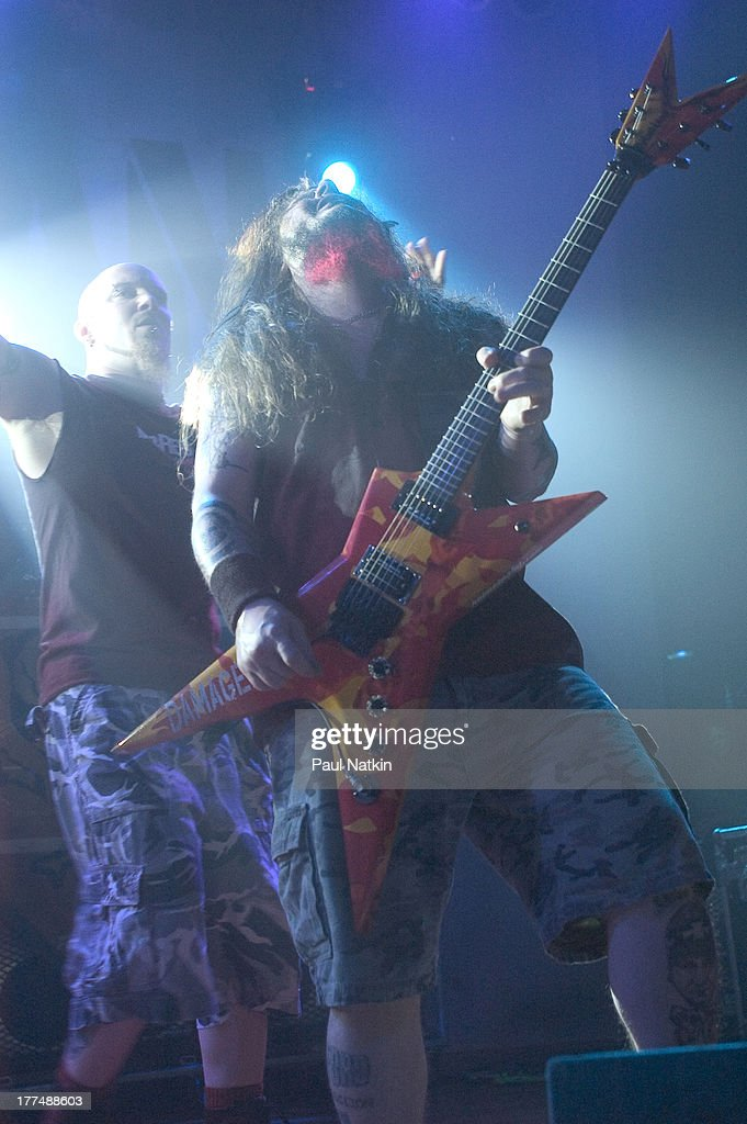 American music group Damageplan performs on stage at the House of Blues, Chicago, Illinois, April 8, 2004. Pictured are Pat Lachman (left) and Dimebag Darrell (born Darrell Lance Abbott, 1966 - 2004).