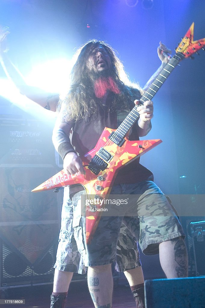 American music group Damageplan performs on stage at the House of Blues, Chicago, Illinois, April 8, 2004. Pictured is Dimebag Darrell (born Darrell Lance Abbott, 1966 - 2004) and, behind him, Pat Lachman.