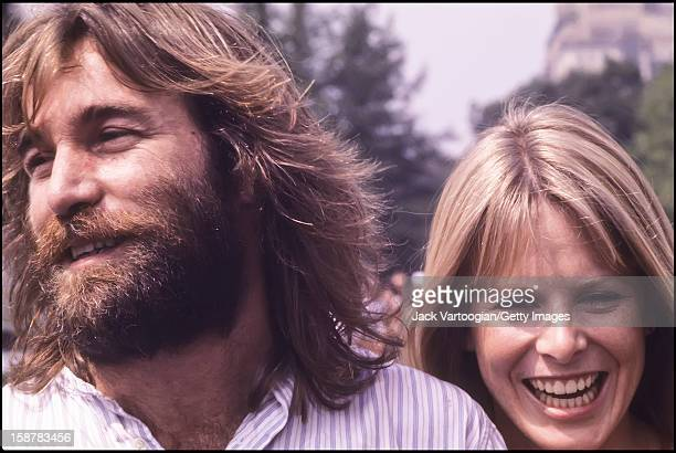 American musican Dennis Wilson of The Beach Boys and his wife actress Karen Lamm prior to a performance at a free concert on the Great Lawn of...
