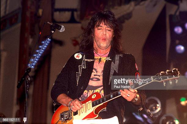 American musician Ace Frehley plays guitar as he performs on stage at the Aragon Ballroom Chicago Illinois September 4 1987
