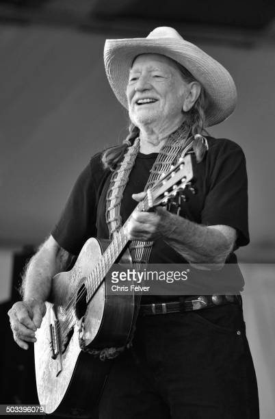 American musician and activist Willie Nelson performs onstage during the New Orleans Jazz Heritage Festival at the Fair Grounds Race Course New...