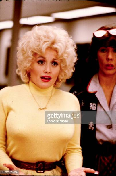 American musician and actress Dolly Parton in a scene from the film '9 to 5' California 1980 Behind her is fellow actress Lily Tomlin