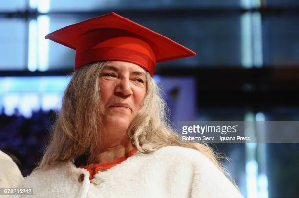 American musician and authoress Patti Smith receives an honorary degree in Literature from the University of Parma during a ceremony at Audtorium...