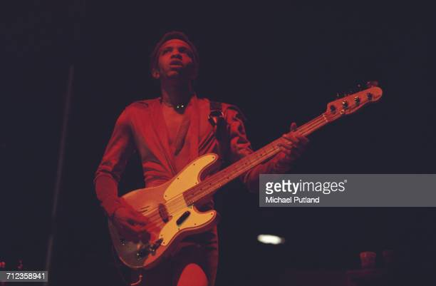 American musician and bass guitarist George Porter Jr performs live on stage with American funk group the Meters in London in 1976
