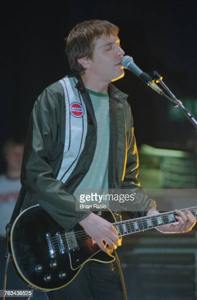 American musician and guitarist Evan Dando of The Lemonheads performs live on stage playing a Gibson Les Paul guitar in London in June 1994