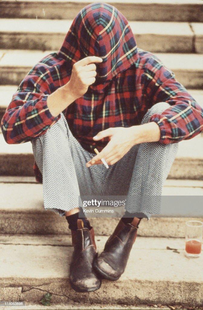 American musician and singer Evan Dando wearing a tartan hoodie circa 1996