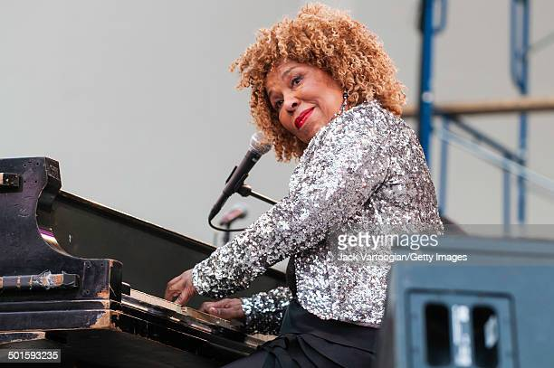 American musician and singer Roberta Flack plays piano on stage at the 'Keep A Light In The Window An Homage To Joel Dorn' concert at Damrosch Park...