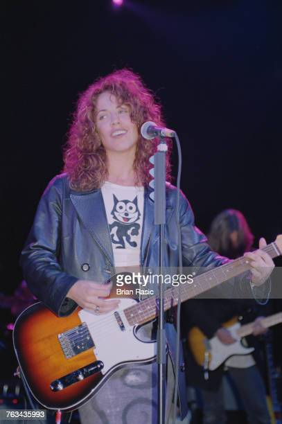 American musician and singersongwriter Sheryl Crow wearing a Felix The Cat tshirt performs live on stage with guitar in London in June 1994