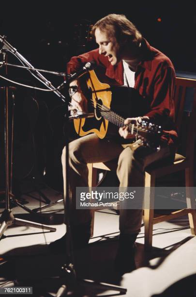 American musician and singersongwriter Stephen Stills performs with an acoustic guitar on the 'In Concert' TV show at the BBC TV Theatre in London in...