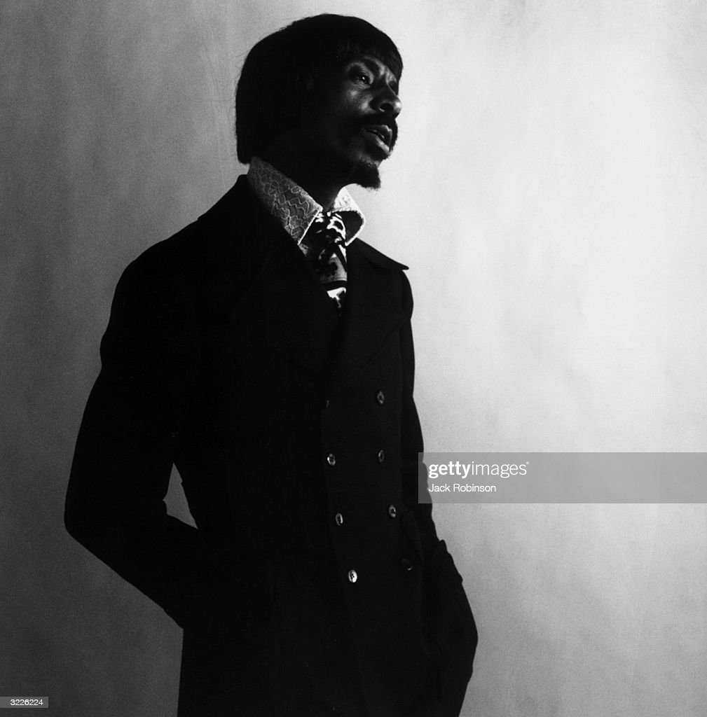 Studio portrait of R&B musician Ike Turner singing while looking into the distance.
