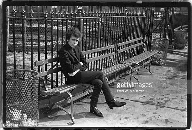 American musician Bob Dylan sits on a bench in Sheridan Square Park New York New York January 22 1965