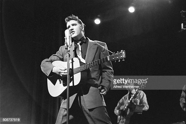 Alfred Wertheimer/Getty Images American musician Elvis Presley performs live on stage at CBSTV's Studio 50 on the Dorsey Brothers' 'Stage Show'...